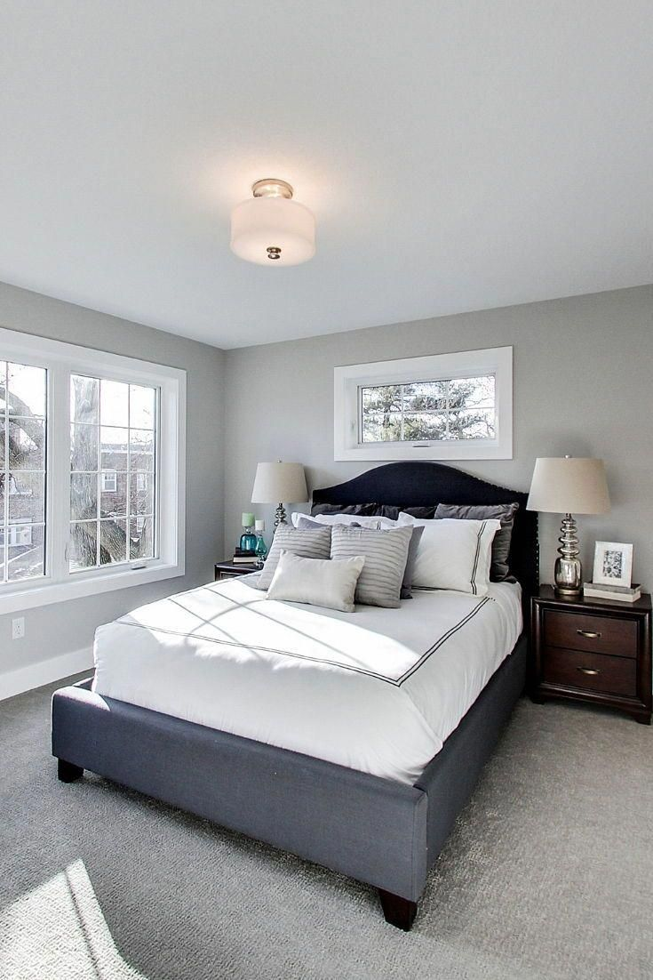 Beautiful Light Filled Master Bedroom With Gray Carpet White Trim