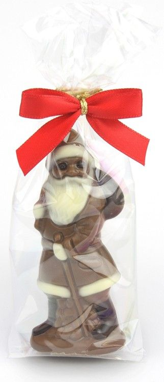 Milk chocolate santa (18g) by Chocolate Trading Co.  A high quality, milk chocolate santa, standing just 8.5cm tall and so perfect for a Christmas stocking filler, Christmas tree decoration or token gift.   Presented in a small clear gift bag finished with festive red ribbon.