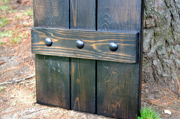 Bistro Walnut Finish with Decorative Clavos / Cedar Board and Batten Shutter / exterior shutters / rustic shutters / stained shutters by GroveJobShop on Etsy https://www.etsy.com/listing/239932425/bistro-walnut-finish-with-decorative