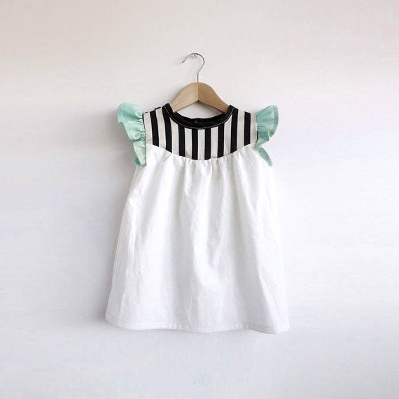 The bodice of this 100% cotton dress is a lightweight ivory broadcloth with black and cream wide stripe yoke and flutter sleeves in a cool mint
