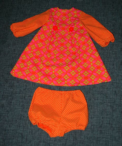 Baby girl dress with match elasticated panties in Shweshwe printed fabric.