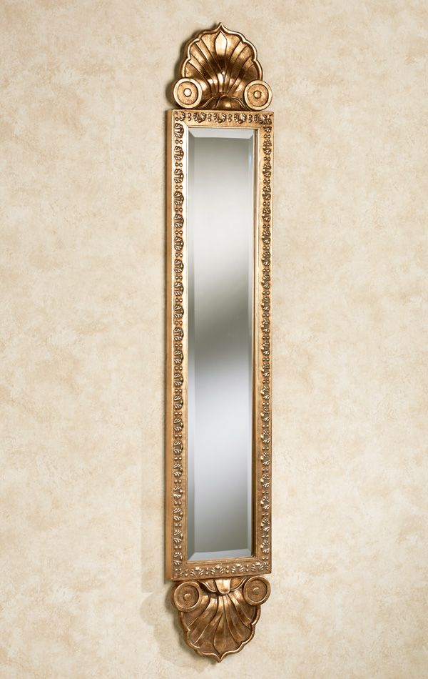 38bf440f31f0 The Shell Sargent Wall Mirror Panel reflects elegance upon your decor.  Finished in soft gold