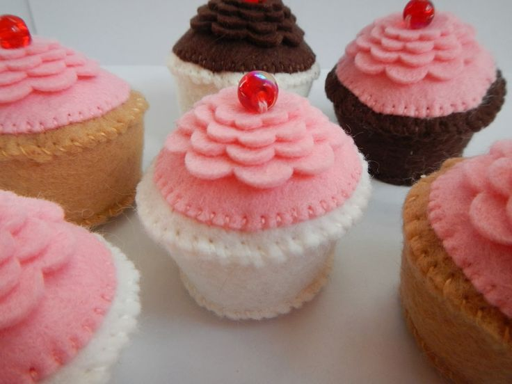 cheriesparetime: Felt Cupcake Pattern - use a little felt heart or other shape instead of bead to keep the cupcake toddler friendly.