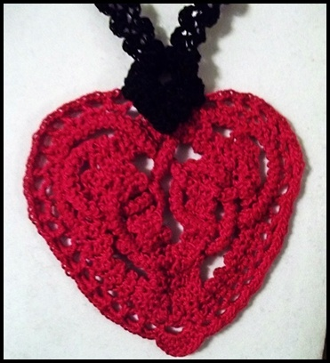 """""""Tangled in Love"""" is an ArtFireEtc's original design, a must have necklace, a fashion statement and a conversation piece for a special Valentine...it is also a one of a kind gift made with love in point lace. #$28.00"""