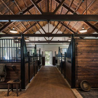 Horse Barns Design Ideas. Love the flooring. Easy to clean. If I ever decide to get horses (most likely never going to happen), this would be the barn of my dreams!