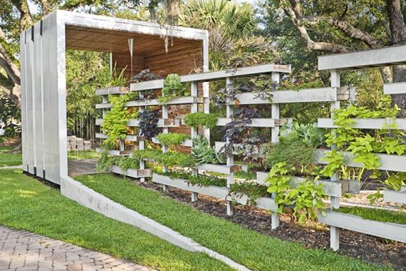 Half fence, half garden, this leafy privacy screen is a cornucopia of smaller plants grown in a series of planter boxes made from water-resi...
