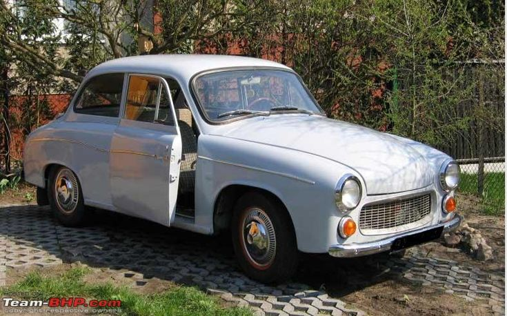 The Polish Syrena - with Suicide Doors - vintage.  My parents had one of these - so cool. :)
