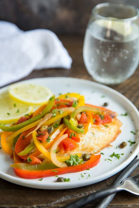 Simple pan-fried Tilapia with lots of colorful bell peppers makes a quick and easy, delicious and healthy meal! A great recipe if you want to eat more fish.