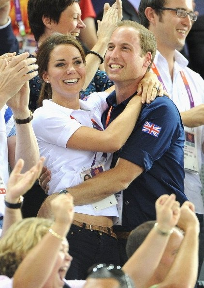 Catherine, Duchess of Cambridge and Prince William, Duke of Cambridge embrace after Philip Hindes, Jason Kenny and Sir Chris Hoy of Great Britain win the gold and a new world record in the Men's Team
