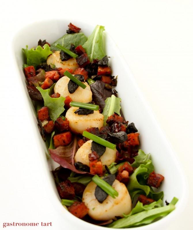 Scallops with Black Garlic, Chorizo  Baby Greens. Full recipe at http://gastronometart.typepad.com/gastronome_tart/2011/04/scallops-with-black-garlic-chorizo-truffled-baby-greens.html