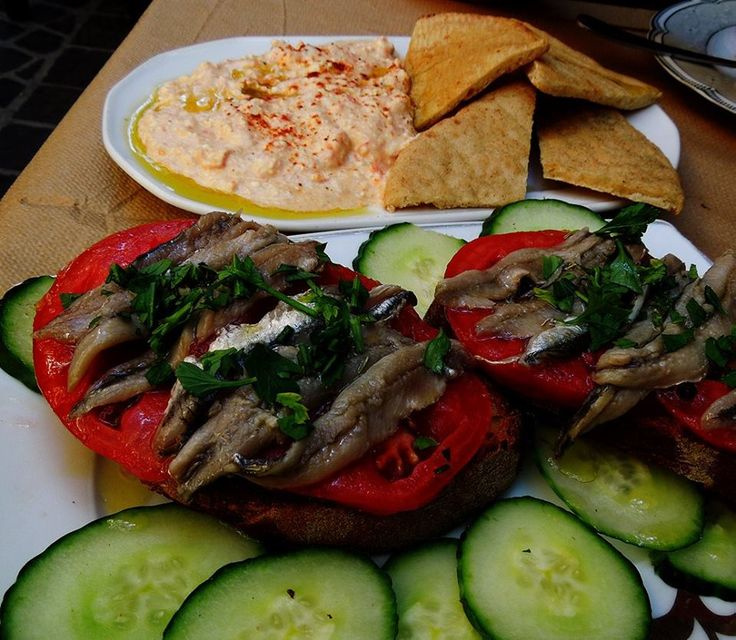 Hot pepper- cheese spread and marinated anchovies
