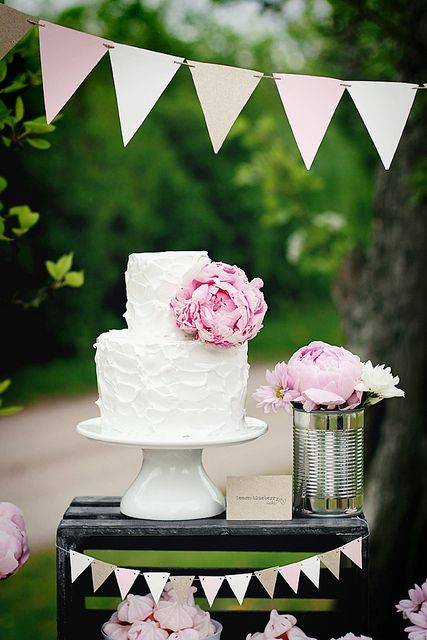 Peonies, this cake, and the adorable bunting would make for an amazing baby shower (or bridal shower) look
