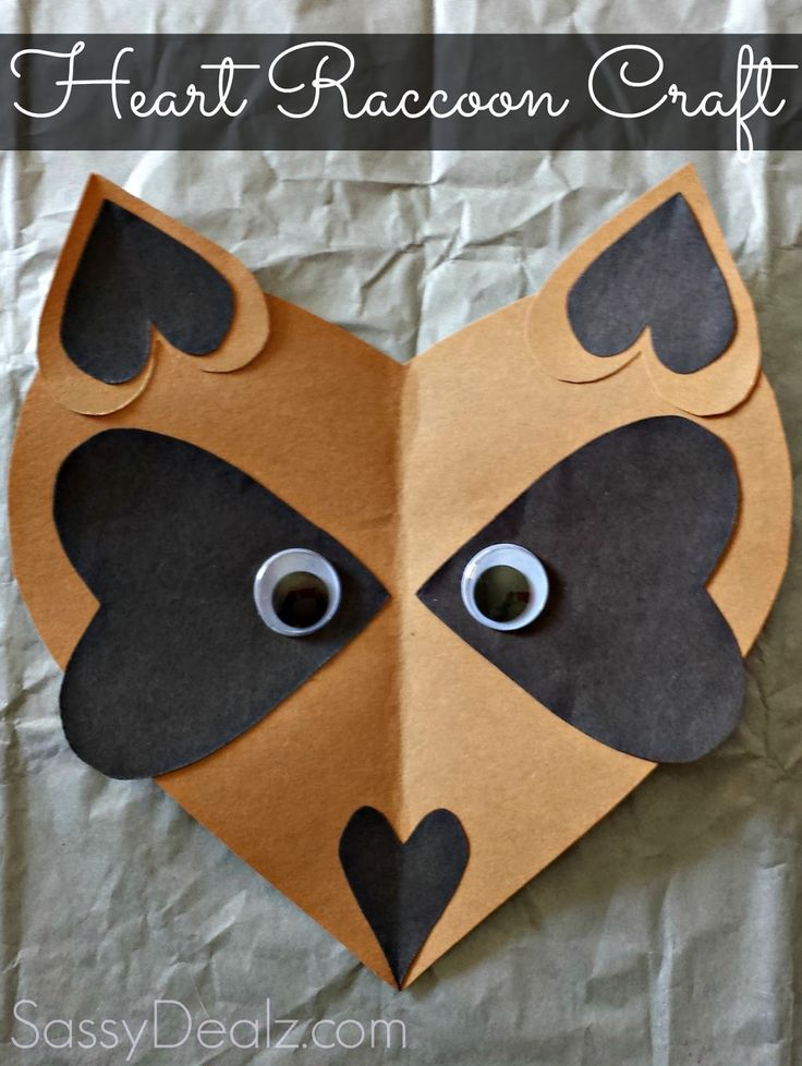 We made a heart raccoon craft today! This is perfect for a Valentine's day art project to do with the kids or if you're just learning about the animals. You will need brown and black construction paper. Cut two medium size black hearts, 2 small, and one skinny small heart. Then cut a big brown heart and two smaller ones. Glue the black hearts onto the face facing outwards, with their points almost touching. Glue the small black hearts inside the small brown ones. These will be the raccoon's…