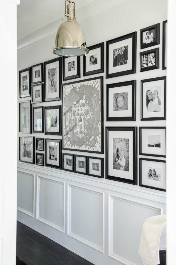 black & white hallway gallery wall with wainscotting.