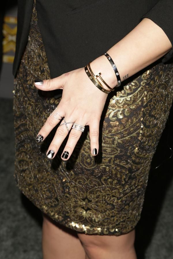 "Demi Lovato Demi wearing a Tiffany & Co. ""Atlas"" open ring, Cartier ""Love"" bracelets and a golden Cartier ""Juste un Clou"" cuff at the X Factor USA Season 3 Finale 
