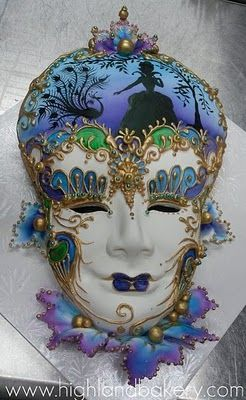 Gorgeously made Venician Carnevale Volto-style mask with such highly intricate detailing and exacting sculpture that it seems impossible for this to be a cake...The artistry is just phenomenal! Created by the talented designers of Highland Bakery in Atlanta, GA....