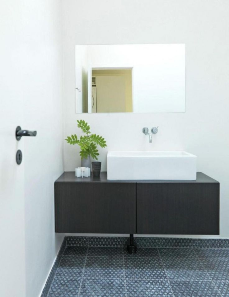 The Wall Mounted Sink Vanity Gives Small Bathroom A More Spacious Feel Plus Frameless Mirror