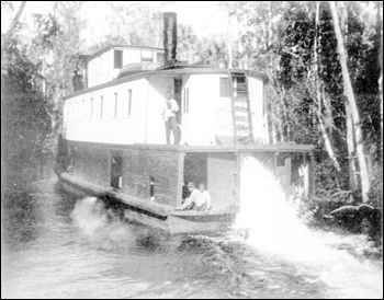 """Steamboat """"Astatula"""" running through the swamp: Marion County, Florida (1892)"""