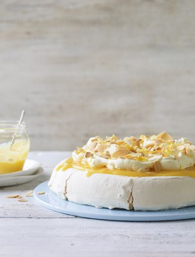 Nigella's pavlova uses lemon curd as an easy topping that also balances the super-sweet meringue wonderfully.