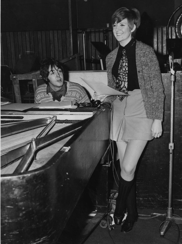 Pop singer and entertainer Cilla Black (Priscilla White) rehearses a song with Paul McCartney in a recording studio; the Beatle has written the song 'Step Inside Love', which will be the theme song for Cilla's new television show.