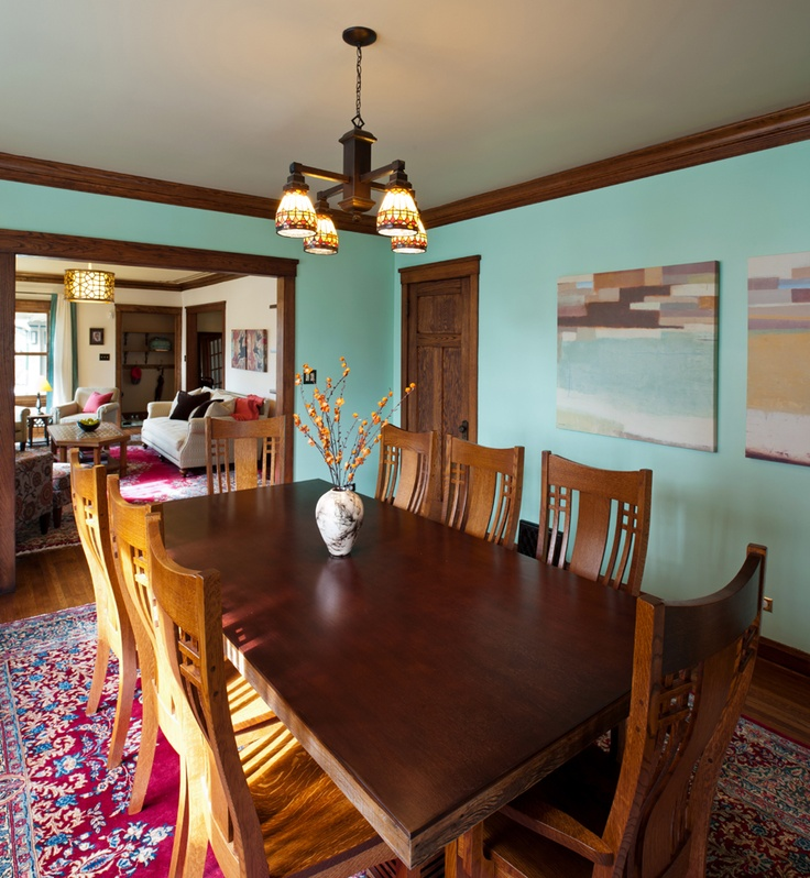 Formal Dining Room, Teal Wall Color, Red Rug With Blue And