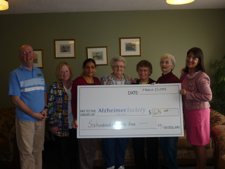 Angee Turnbull Community Engagement Officer is presented at cheque for $675.00 by the staff and residents of   Amber Lea Nursing Home for the Walk For Memories fundraiser.  Left to right Keith Barrett-Activity Director, Suzanne George RPN, Ruby Toor Director, Shirley Lawrence, Ruth Greenslade ( who raised $534.00)  Audrey Headily