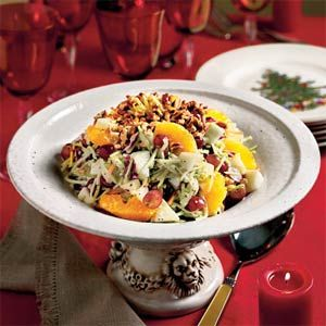 Broccoli Slaw...1 (12-ounce) package fresh broccoli slaw  1 c red seedless grapes, halved...  1 Granny Smith apple, diced...  1 c Vidalia onion or poppy seed dressing...  2 oranges, peeled & sectioned ...  Toasted chopped pecans (optional)