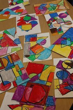 Learning shapes by randomly drawing them around a paper and coloring the shapes created by the overlapping shapes.