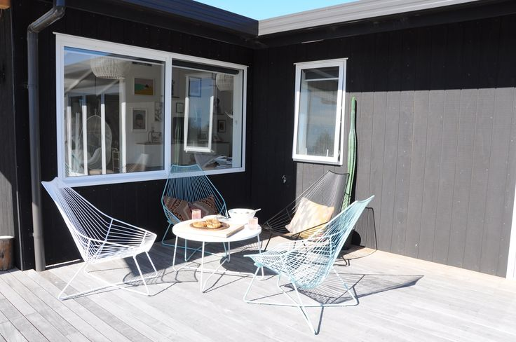 Wire outdoor chairs by icotraders.co.nz Coromandel chair, Piha lounger and the Akaroa table.