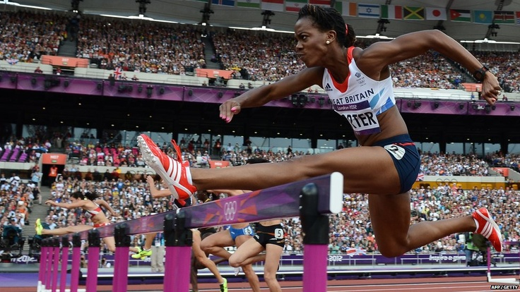 Great Britain's Tiffany Porter jumping over a hurdle