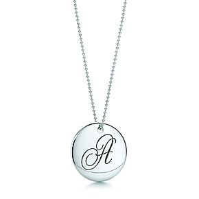 Tiffany Notes letter round pendant in sterling silver. Letters A-Z available.