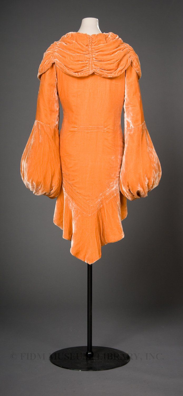 Love this vintage velvet coat. Not so much the color though. I have never been a fan of orange....................
