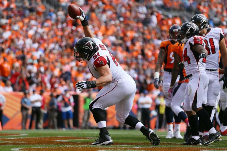 Falcons vs. Broncos:   October 9, 2016  -  23-16, Falcons.     Center Alex Mack #51 of the Atlanta Falcons spikes the football after Devonta Freeman #24 scored a touchdown in the first quarter of the game against the Denver Broncos at Sports Authority Field at Mile High on October 9, 2016 in Denver, Colorado.