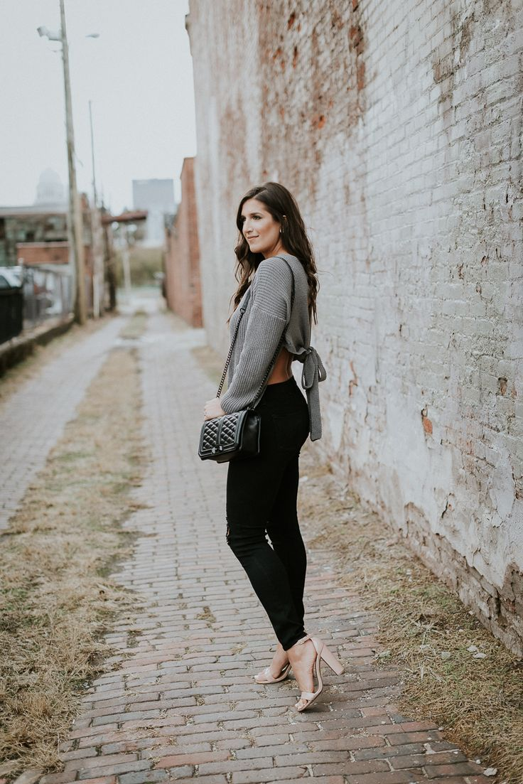 Tie Back Sweater | A Southern Drawl. Grey wrap tie back sweater+black distressed skinny jeans+nude ankle strap heeled sandals+balck chain shoulder bag. Winter Casual Evening Outfit 2017