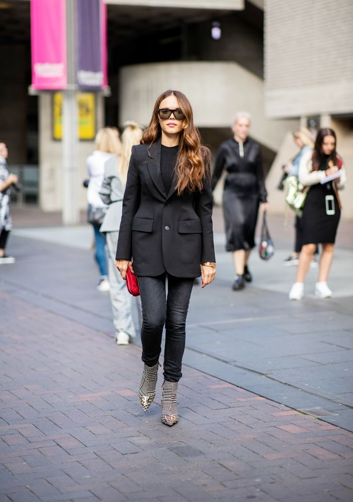 e659fa7d08dcc Pair your black jeans with a blazer and printed ankle boots for a cool work outfit  you can also wear to dinner after.