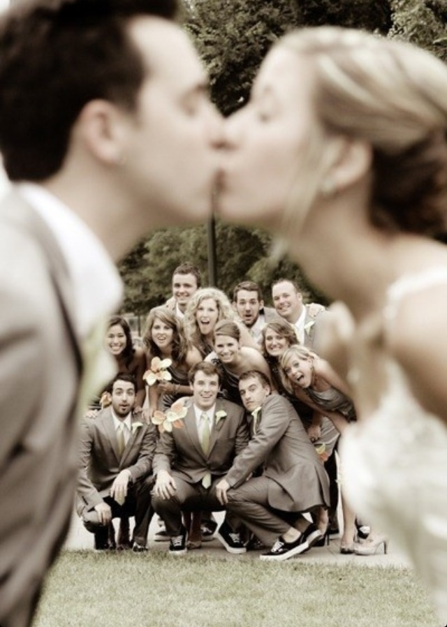 Wedding Photo Pose with couple kissing and wedding party in the background. Nervous to shoot my first wedding!!
