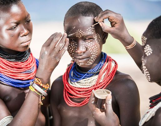 The Karo men are best known for the elaborate body painting they indulge in before important ceremonies. They paint their faces and bodies in white chalk and pierce their ears in five places [Massimo Rumi / Barcroft Media]