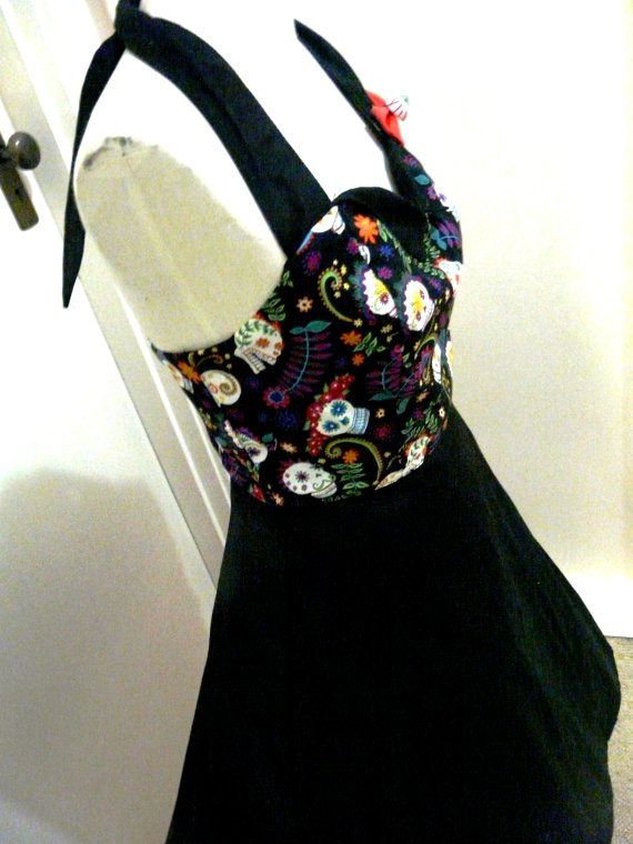 Day of the dead sugar skull dress! Great spring/summer dress! Perfect for lovers of rockabilly, day of the dead, sugar skulls and psychobilly! It has a great amount of flare - but not too much so its bulky! The bodice features sugar skull fabric and beautiful flowers and patterns. And