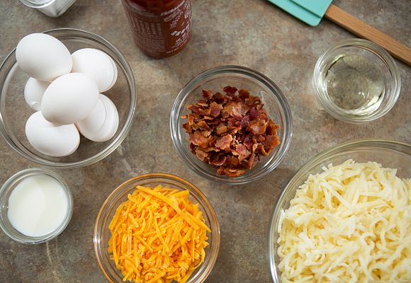 Ingredients for Breakfast Cupcakes with bacon, hash browns, cheese and eggs.  Great idea for brunch or company.