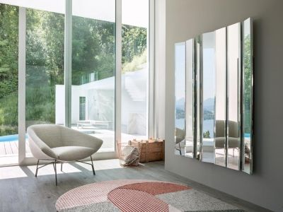 LEMA   Retrò creations with modern balance for Lennox lounge chair by Gordon Guillaumier. This refined design is inspired to an open corolla, suspended into the void, on the light structure in metal in bronze colour, which turns into an idea for an elegant and discreet armchair for conversations.