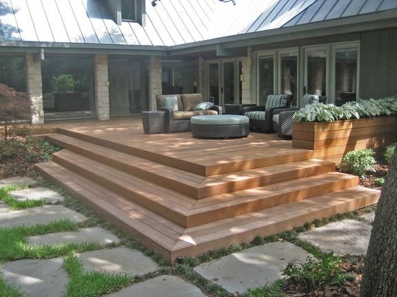 deck steps down to a paver patio