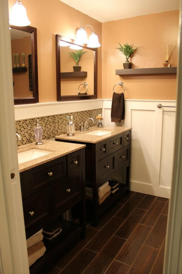 Double vanity bathroom-like the idea of the separate sinks and the board on walls and backsplash