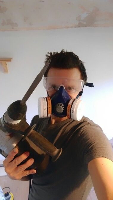 Ok let's do this! SDS drill in hand, ready to remove the old render from the bedroom walls