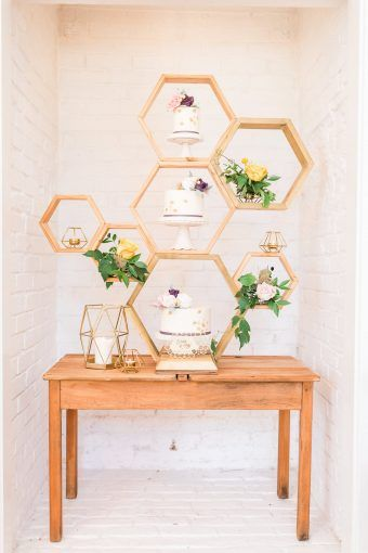 Camilla J Hards Photography and Party Squared create a fun bright wedding inspired by Bees with honeycomb details like this geometric wedding cake stand and dessert table! See the full feature on B.LOVED Blog!
