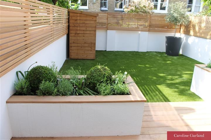 Near a London Park in Fernside, Balham in South London, Caroline Garland, London Garden Designer has created a low maintenance garden with false grass...