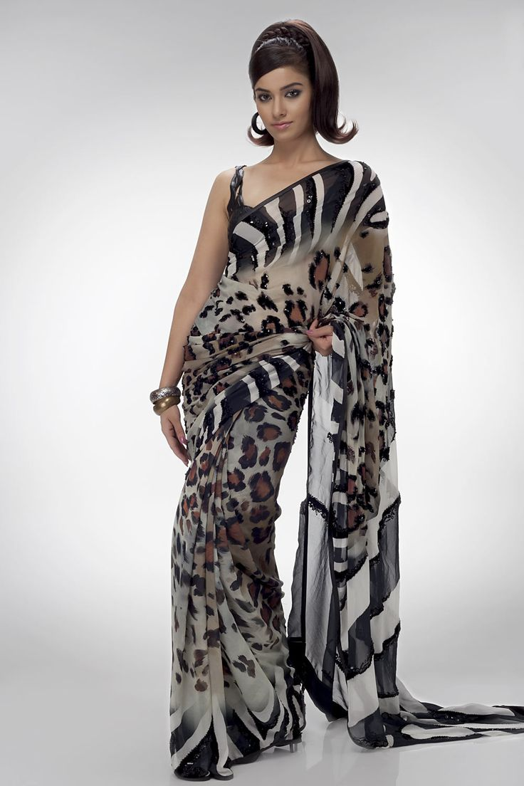 A digital printed sari in georgette fabric, comes with an unstitched crepe-de-chine blouse piece.Shop online at www.satyapaul.com and Join our facebook page at www.facebook.com/SatyaPaulIndia