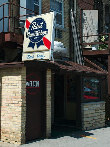 A image of a Pabst Beer Sign over the door of the Bank Shot Tavern in Hartford, WI.