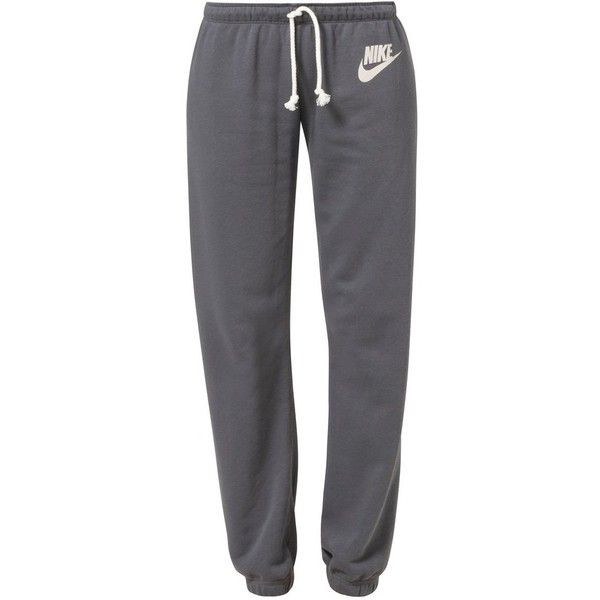Nike Sportswear RALLY Tracksuit bottoms dark ($49) ❤ liked on Polyvore featuring activewear, activewear pants, pants, bottoms, sweatpants, jeans, grey, grey sweat pants, nike activewear and nike sweatpants