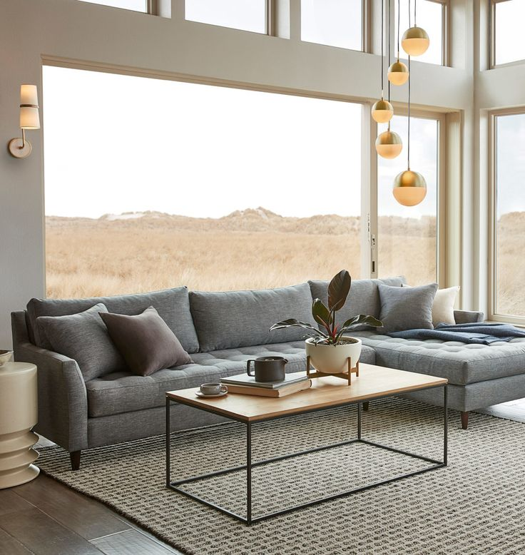 Hastings Sectional Sofa. Chaise Right. Rejuvenation couch. Made in the USA. Casual modern design. Tufted seat cushions. Oversized chaise. Modern silhouette sofa. Forest Stewardship Council (FSC)-certified wood. Feather and down blend accent pillows. Made in USA.