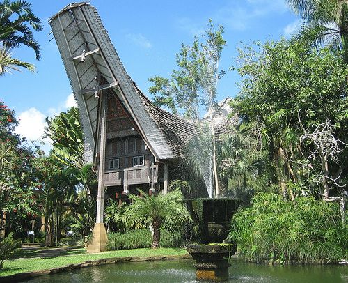 Distinctive Toraja House, Bali Bird Park, Bali, Indonesia.Another unexpected surprise was to find the distinctive Toraja House from Central Sulawesi! A bit of culture in this beautiful park in Bali, Indonesia.
